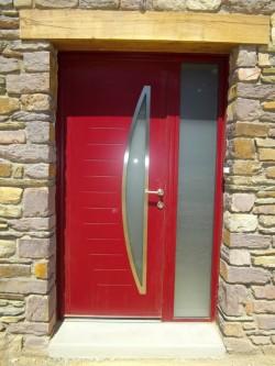 Pose d'une porte d'entrée Lagune - Bernard Fromentoux.jpg